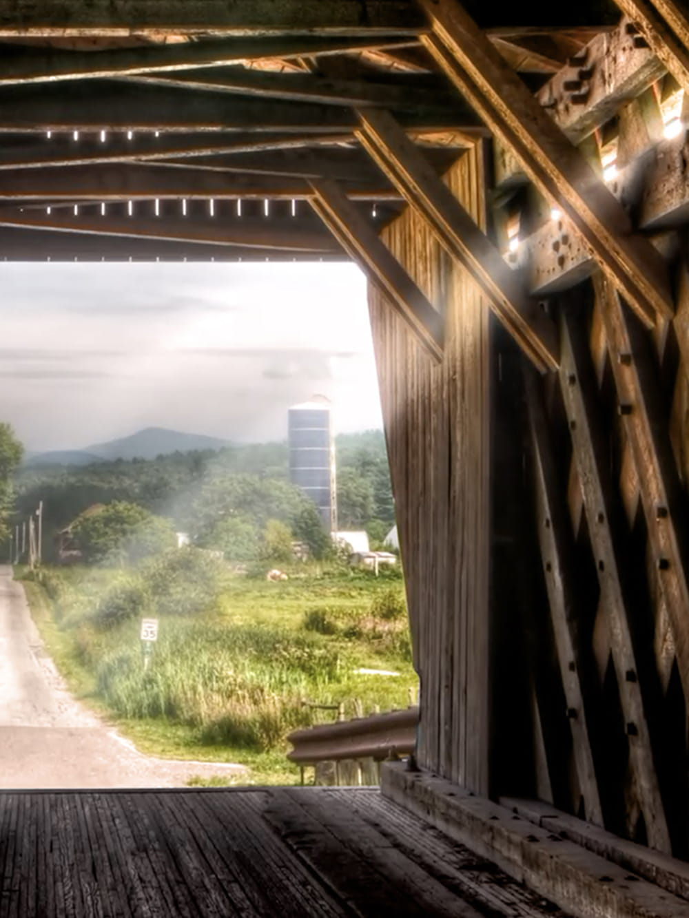 Picturesque view of rural area through bridge